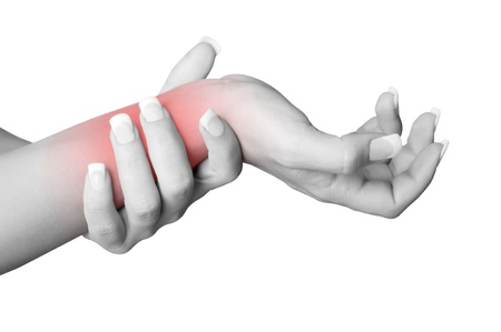 Female with pain in her wrist, isolated in a white background. Red circle around the painful area.