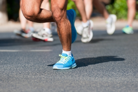 Group of marathon racers running on a street