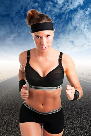 Young fit woman jogging,with a road behind and mountains photo