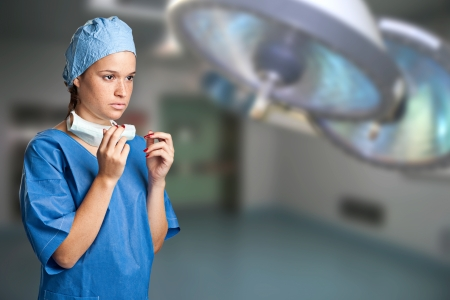 Young female surgeon getting ready for a surgery photo
