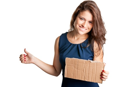 hitch hiker: Young woman hitch hiking, holding a cardboard, isolated on a white background Stock Photo