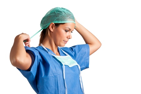 Young female surgeon getting ready for a surgery, isolated in a white background Stock Photo - 16216544