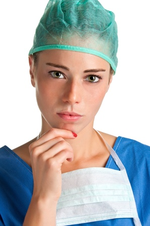 Young female surgeon with scrubs, thinking, on a white background Stock Photo - 16300981