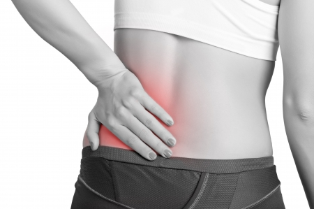 woman back pain: Young woman with pain in her lower back