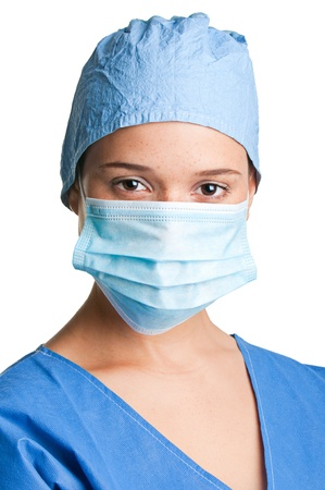 Young female surgeon with scrubs, holding a face mask on a white background Stock Photo - 17191244