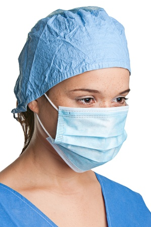 Young female surgeon with scrubs, holding a face mask on a white background Stock Photo - 17190360