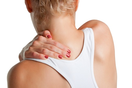 cramped: Young woman with pain in the back of her neck, isolated in a white background