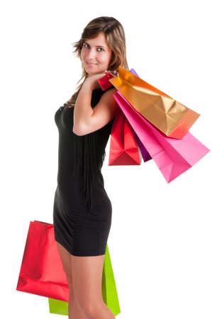 Woman Carrying Shopping Bags isolated in a white background Stock Photo - 17725767