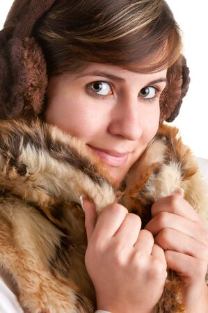 Cold Woman Snuggling in Warm Coat isolated in a white background photo