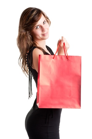 Woman Carrying Shopping Bags isolated in a white background Stock Photo - 19116954