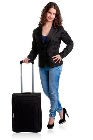 Businesswoman dressing smart casual clothes, holding a black suitcase, isolated in white photo