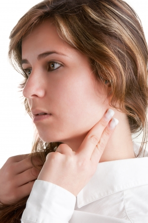 Woman checking her heart heart rate holding her fingers to her neck, isolated in white