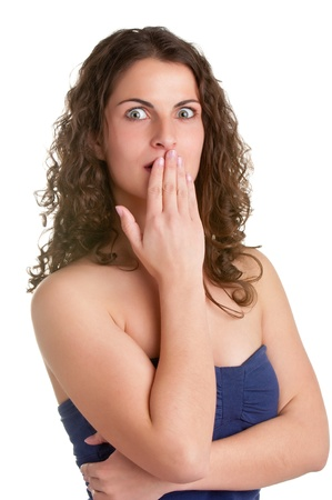 embarrassed: Shocked Woman Covering her Mouth with her hand, isolated in a white background