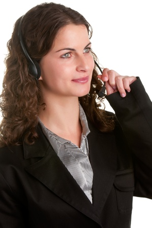 Corporate woman talking over her headset, isolated in a white background Stock Photo - 19691956