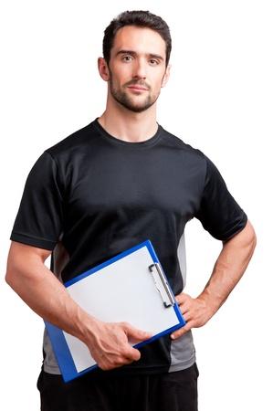 Personal Trainer, met een kussen in zijn hand, geïsoleerd in het wit Stockfoto