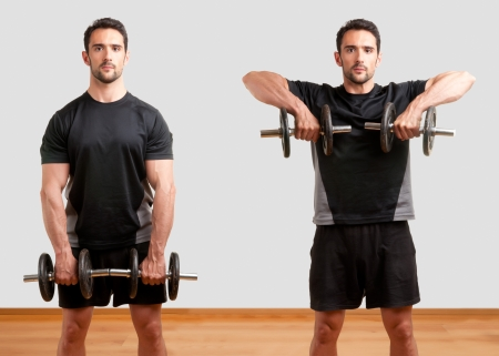upright: Personal Trainer doing dumbbell upright row for training his deltoids Stock Photo