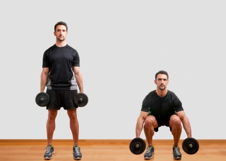 Personal Trainer doing dumbbell squat for training his legs