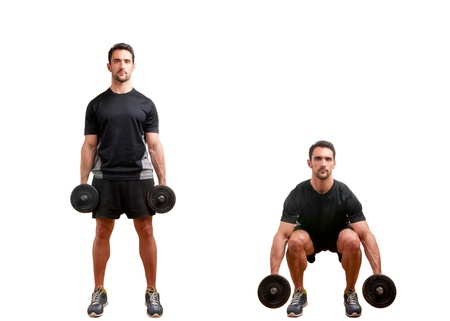 Personal Trainer doing dumbbell squat for training his legs, isolated in white