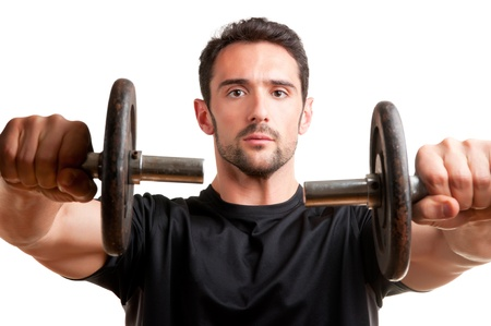 deltoids: Personal Trainer doing front dumbell raises for training his deltoids, isolated in white Stock Photo