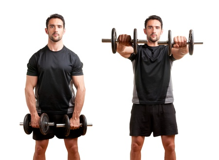 raises: Personal Trainer doing front dumbell raises for training his deltoids, isolated in white Stock Photo