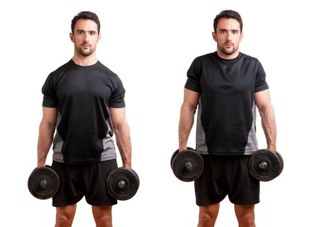 shrugs: Personal Trainer doing dumbbel shrugs for training his trapezius, isolated in white
