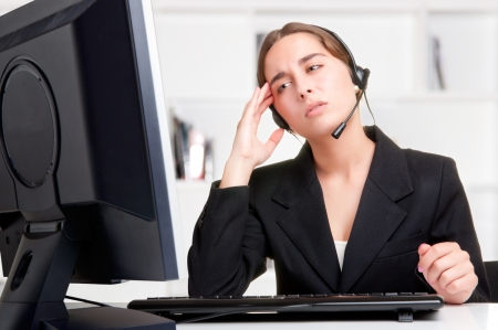 Corporate woman talking over her headset photo