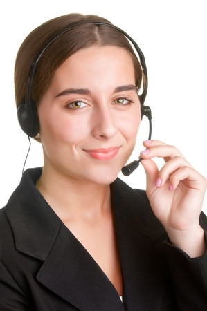 Corporate woman talking over her headset, isolated in a white background Stock Photo - 20484320