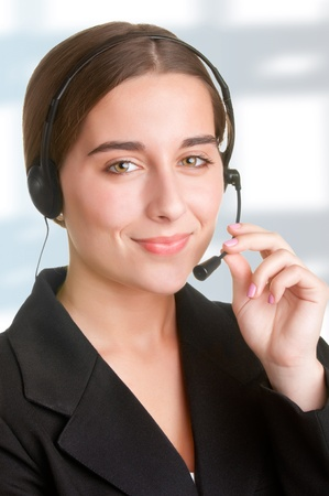 Corporate woman talking over her headset Stock Photo - 20484321