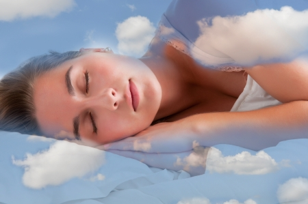 Woman sleeping in the clouds and dreaming Stock Photo