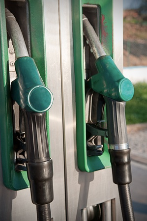 gritty: Closeup of fuel nozzles at a gas station  Gritty look