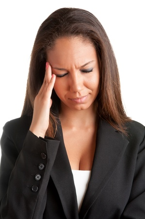 Business woman suffering from an headache, holding her hands to the head photo