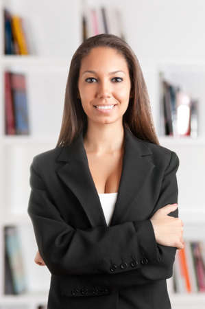 Portrait of a young african business woman with her arms crossed, smiling, in an office Stock Photo - 21382859