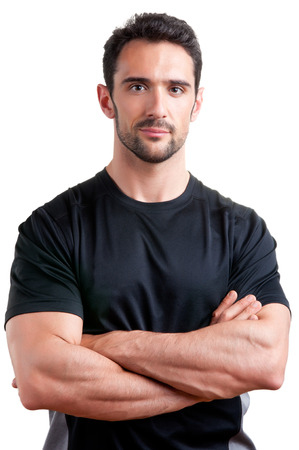 Personal trainer avec est les bras croisés, isolé en blanc Banque d'images