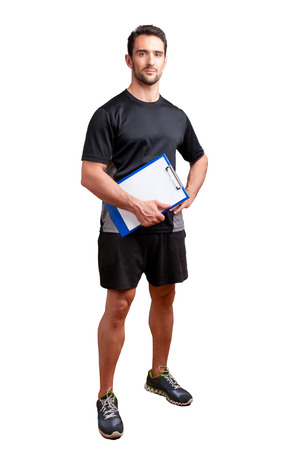 Personal Trainer, with a pad in his hand, isolated in white Stockfoto