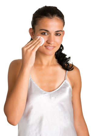 removing make up: Woman removing her make-up isolated in white