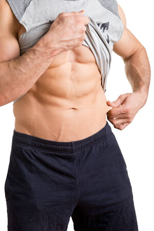 pinch: Male athlete pinching fat from his waist, isolated in white