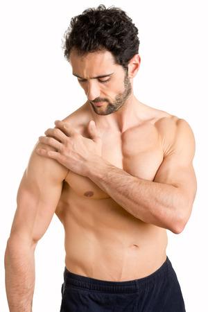 Man athlete with pain in his shoulder Banco de Imagens