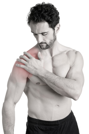 Man athlete with pain in his shoulder.Black and White with a red spot around the painful area. Isolated.