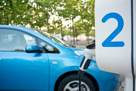 hybrid car: Electric car being recharged on a service station, in the street
