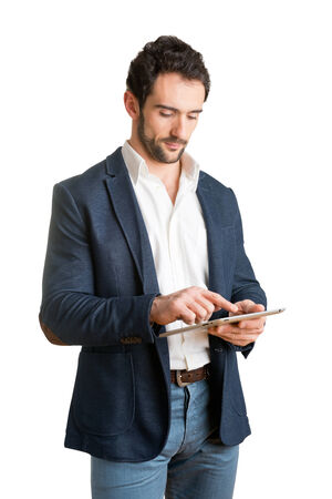 Casual Businessman Looking at a tablet, isolated in white photo
