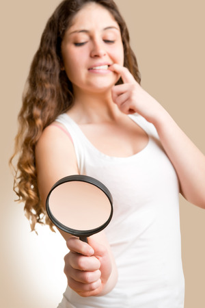 Concept of woman looking at a man with a small penis with a loupe