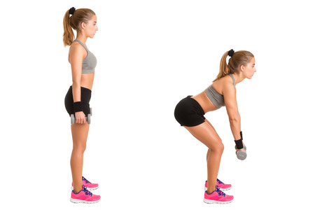 Female doing dumbbell deadlifts isolated in white