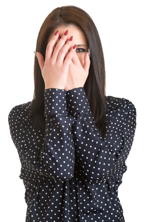 hand covering eye: Shy girl covering up her face with her hands, isolated