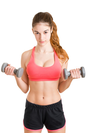 bicep: Woman working out with dumbbells at a gym, isolated in a white background