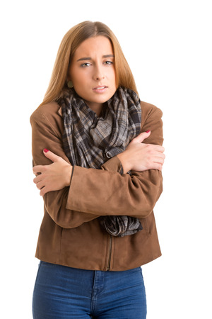 Woman feeling cold, isolated in white