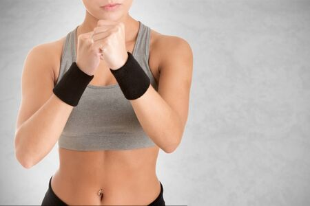 female boxer: Female Boxer Ready to Fight isolated in grey