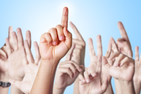 bodypart: Group of people raising hands to answer a question