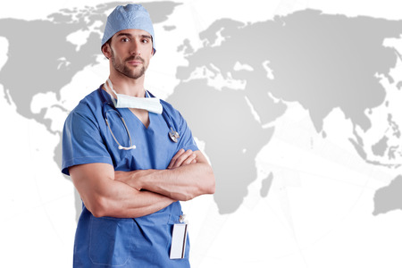 Young male surgeon with scrubs and a stethoscope Imagens