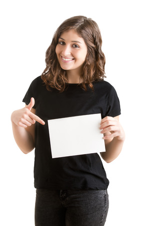 notecard: Young happy woman holding a blank business card on a white background Stock Photo