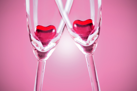 two hearts: Red jelly hearts in champagne flutes, grey background